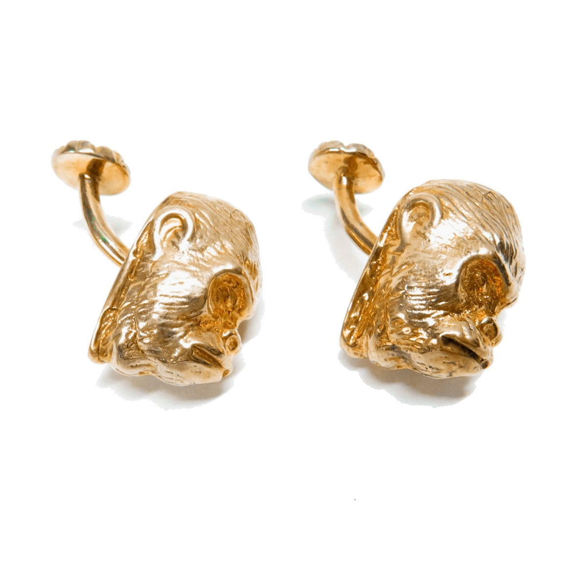A pair of cufflinks  in the form of a Gorilla Heds. They are made of Sterling Silver and 24ct N18 Polished Gold.