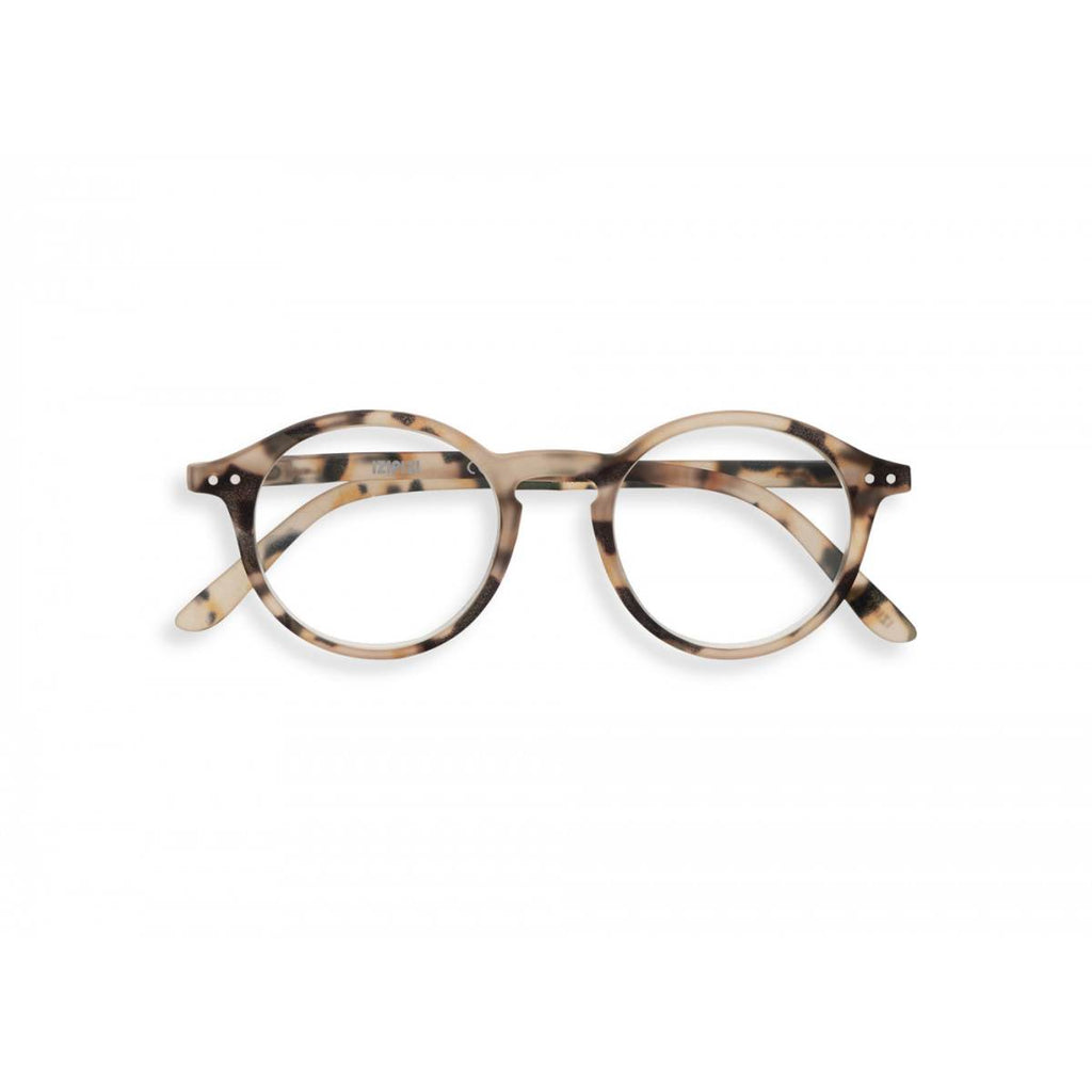 A pair of magnifying reading glasses. The frames are an round, timeless, best-selling shape in a mottled light tortoise shell finish.