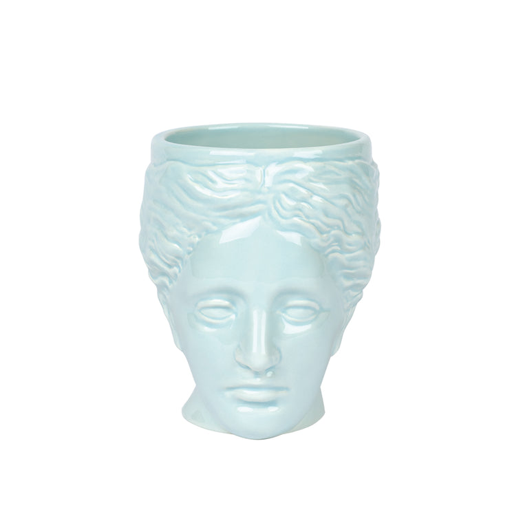A ceramic mug in the shape of a sculptural portrait of  Philotes Goddess of Friendship in pastel blue