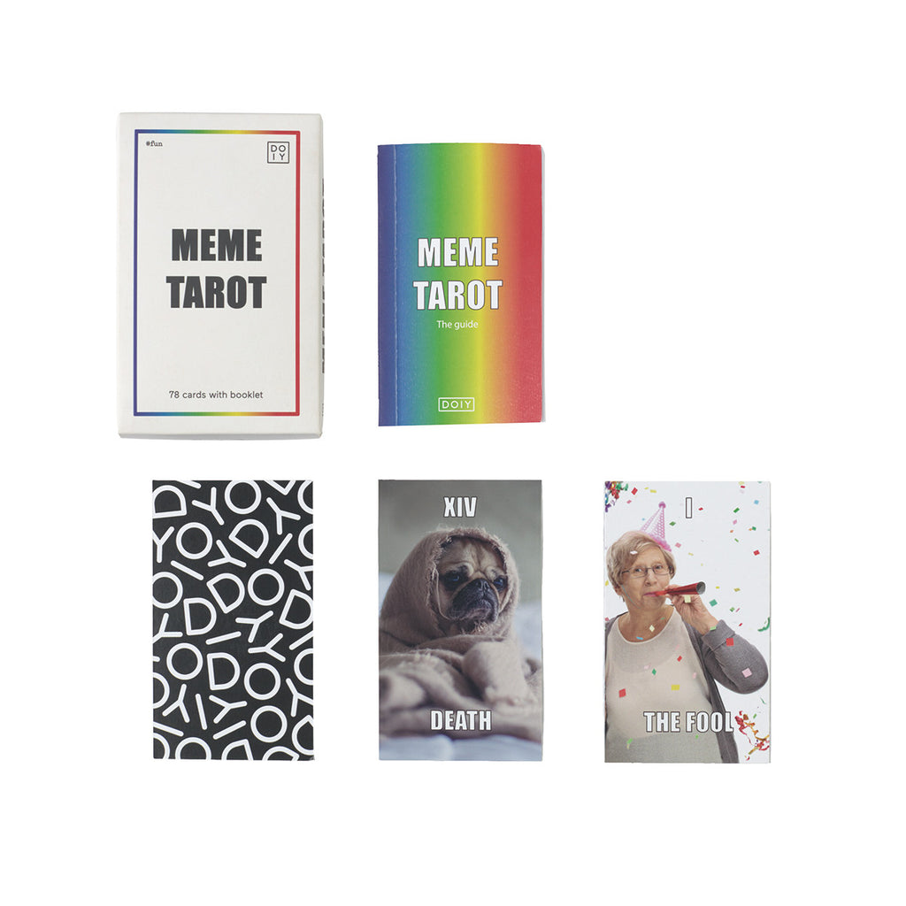 Image featuring Packaging of Meme Tarot with the Meme tarot guide next to it which appears with a rainbow cover, then underneath the packing features three cards one with the Doiy logo then on the left is a picture of a pug in a blanket and then the next card features an older woman with a celebration background