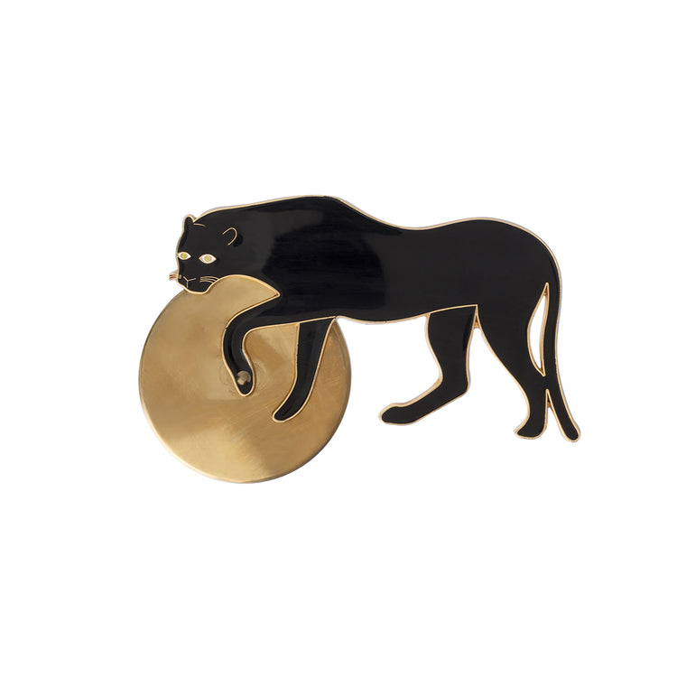A pizza cutter in the shape of a black panther. A golden cutting wheel is attached to the Panthers legs. The panther is a glossy black enamel on gold and used as the handle of the pizza cutter.