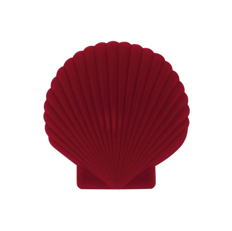 A red velveteen jewellery box in the shape of a shell