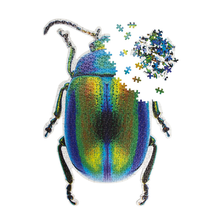 A cute puzzle in the shape and print of a iridescent scarab beetle. Featuring iridescent colours including bright yellow, orange and green contrasted against deep blue and black. Shown almost complete.