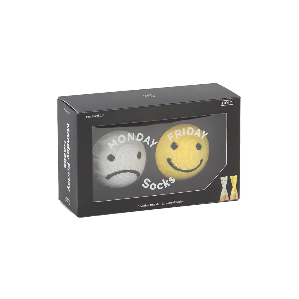 Black Packing featuring two pairs of socks inside one with a sad face in grey and then one with a happy face in yellow, both featuring monday and friday on them