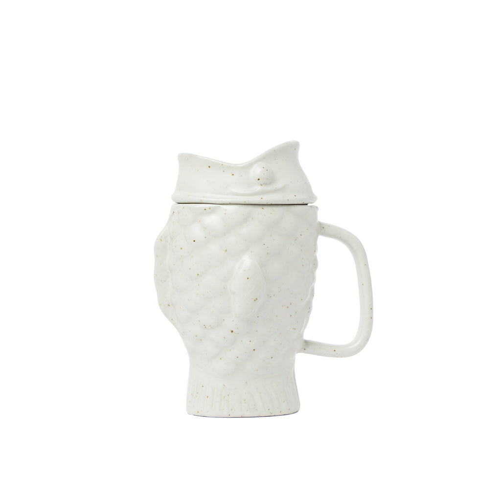 A cream Dolomite ceramic mug shaped like a Japanese taiyaki cake (a waffle cake with filling, shaped like a fish). The glaze is lustrous matte and slightly speckled.