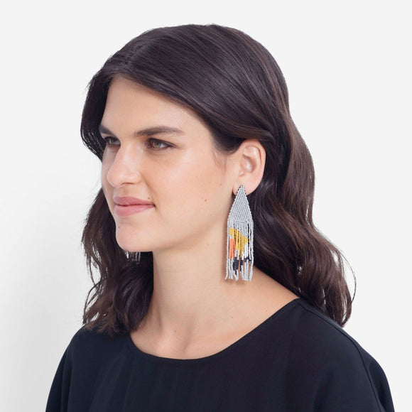 A densely beaded pair of drop earrings consisting of a woven beaded triangle in tiny grey beads and a multi colour fringe.,