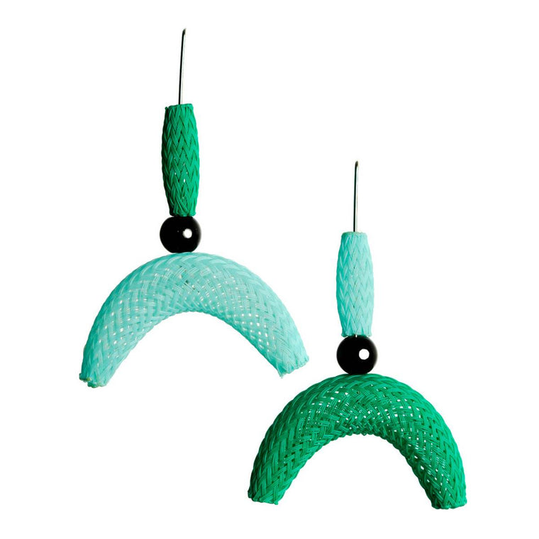 A pair of nylon mesh earrings featuring tube and semi-circle 'moon' shapes in teal and green