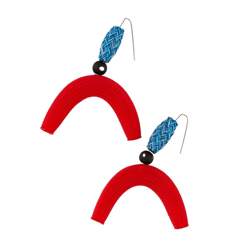 A pair of nylon mesh earrings featuring tube and semi-circle 'moon' shapes in red and blue