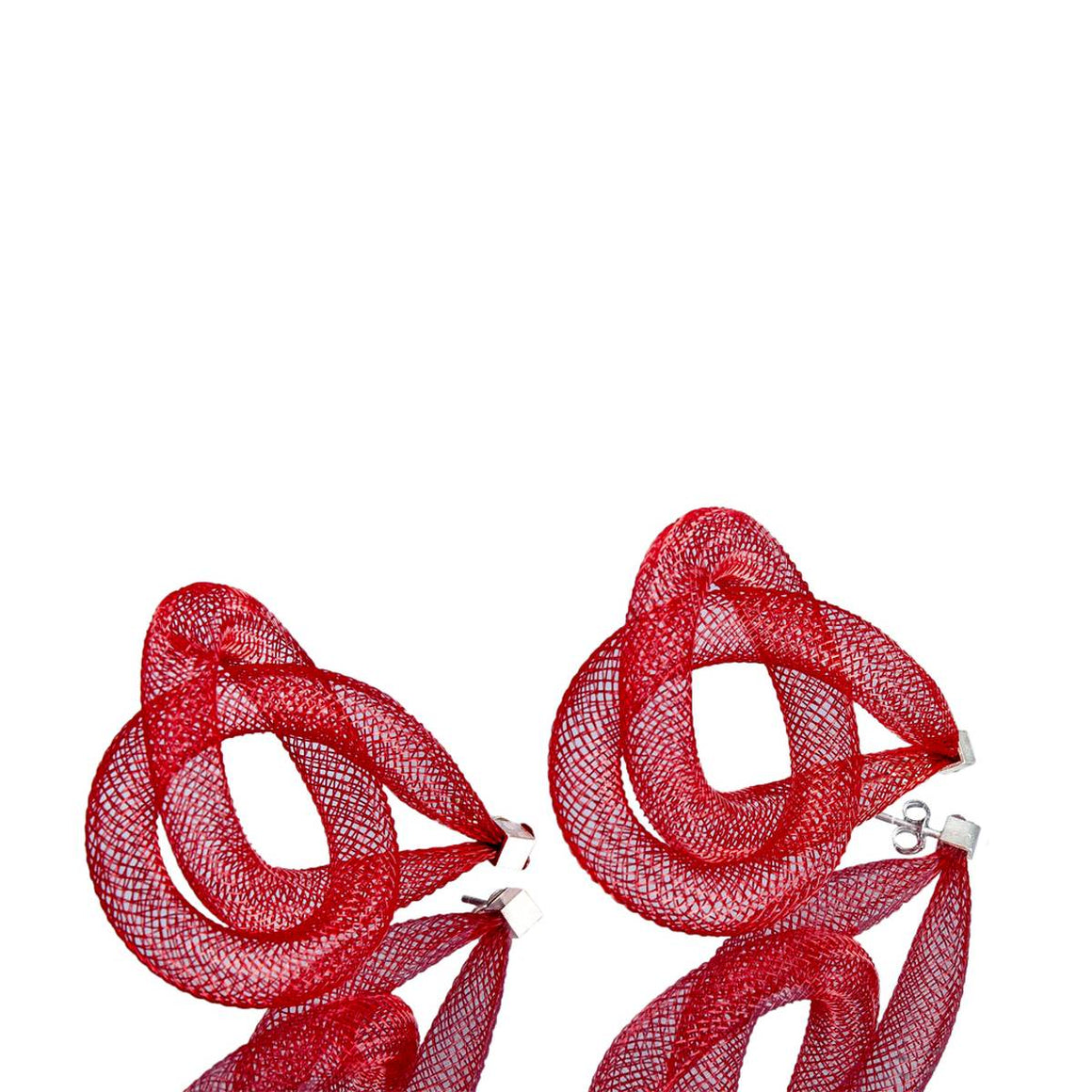 A pair of red earrings made from finely woven nylon mesh formed into tubing. Each earring is a knot of  red mesh tube.