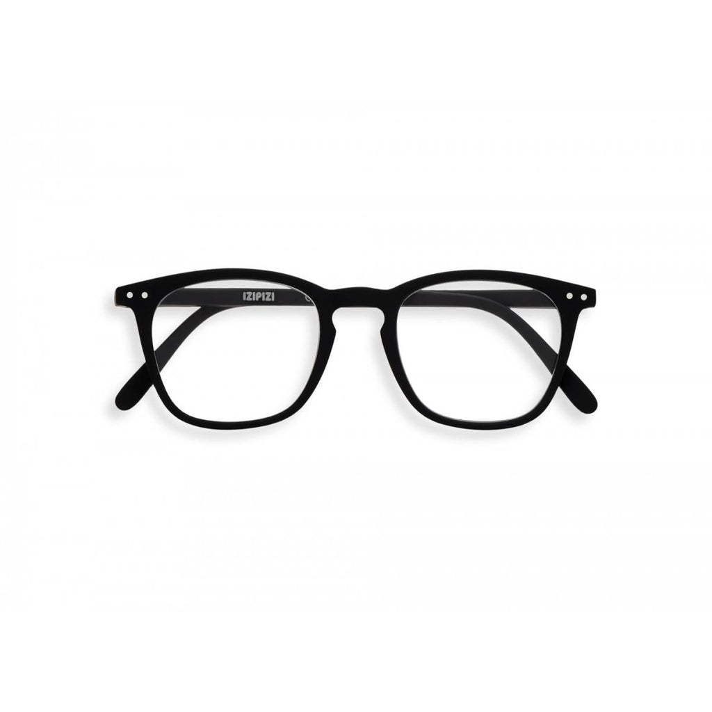 A black pair of magnifying reading glasses. The frames are a large, structured, trapezium shape.
