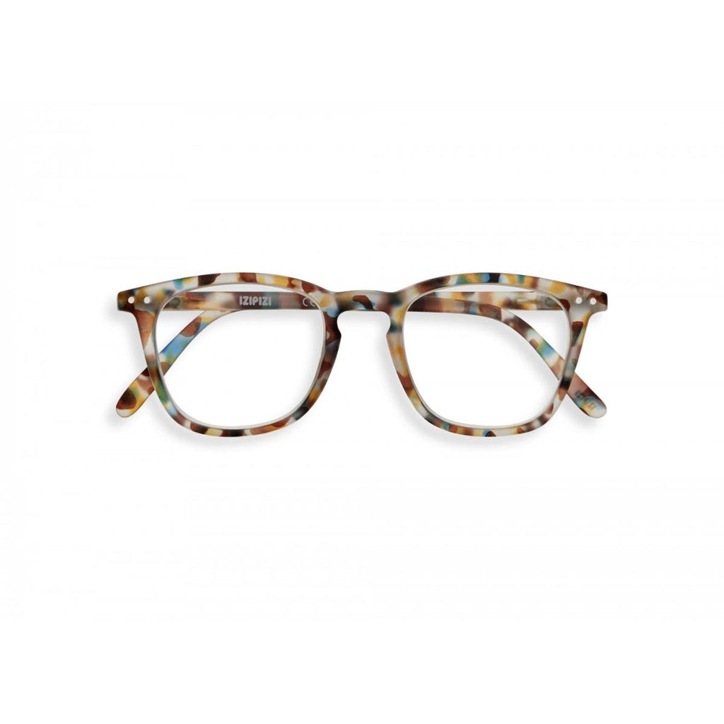 A pair of magnifying reading glasses. The frames are a large, structured, trapezium shape in a mottled blue tortoise shell finish.