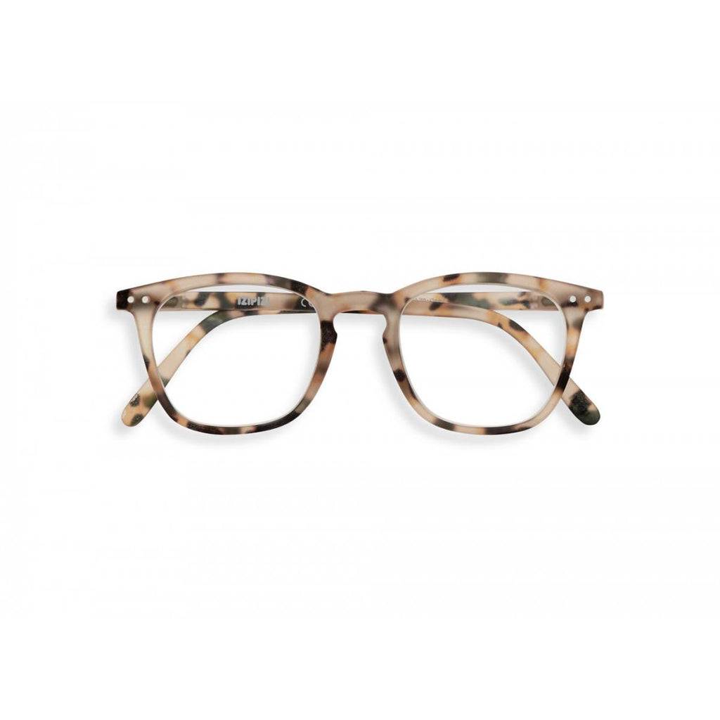 A pair of magnifying reading glasses. The frames are a large, structured, trapezium shape in a mottled light tortoise shell finish.