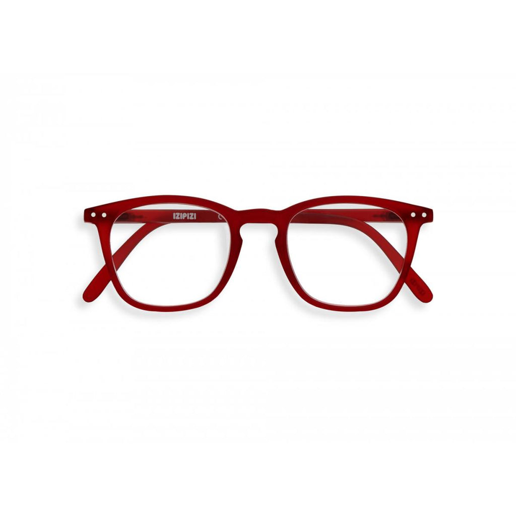 A pair of slightly translucent red magnifying reading glasses. The frames are a large, structured, trapezium shape.