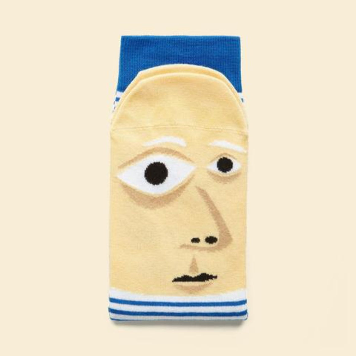 Image of a pair of socks which feature a graphic illustration of Pablo Picasso