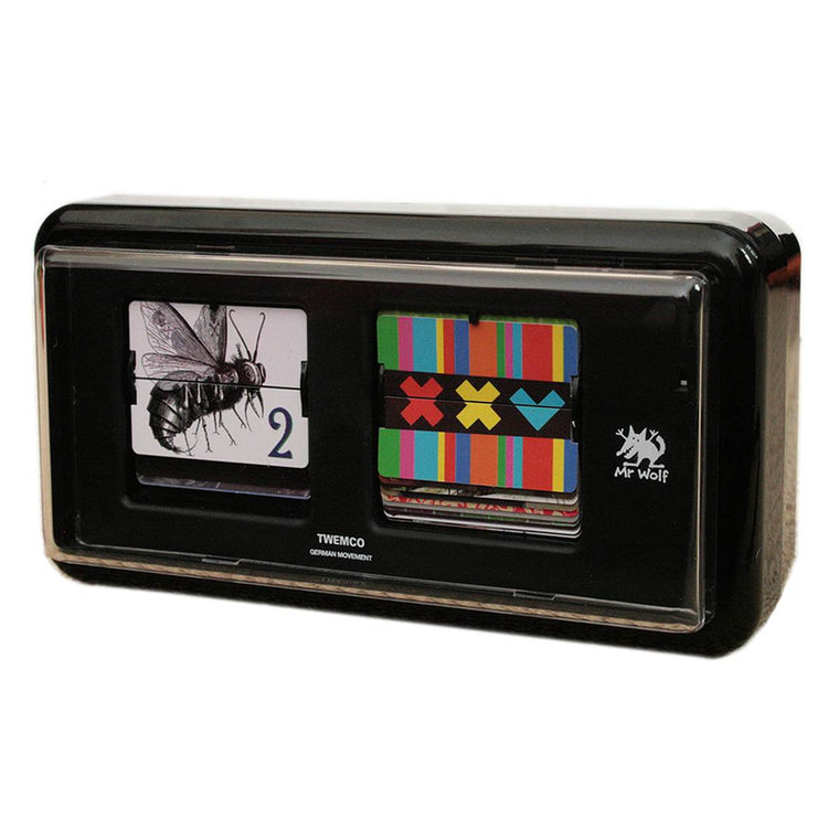 A designer clock in the style of traditional 24 Hour military flip clocks. This one however has replaced the traditional number plates with a range of images that refer to numbers. Housed in a black retro flip clock style box.