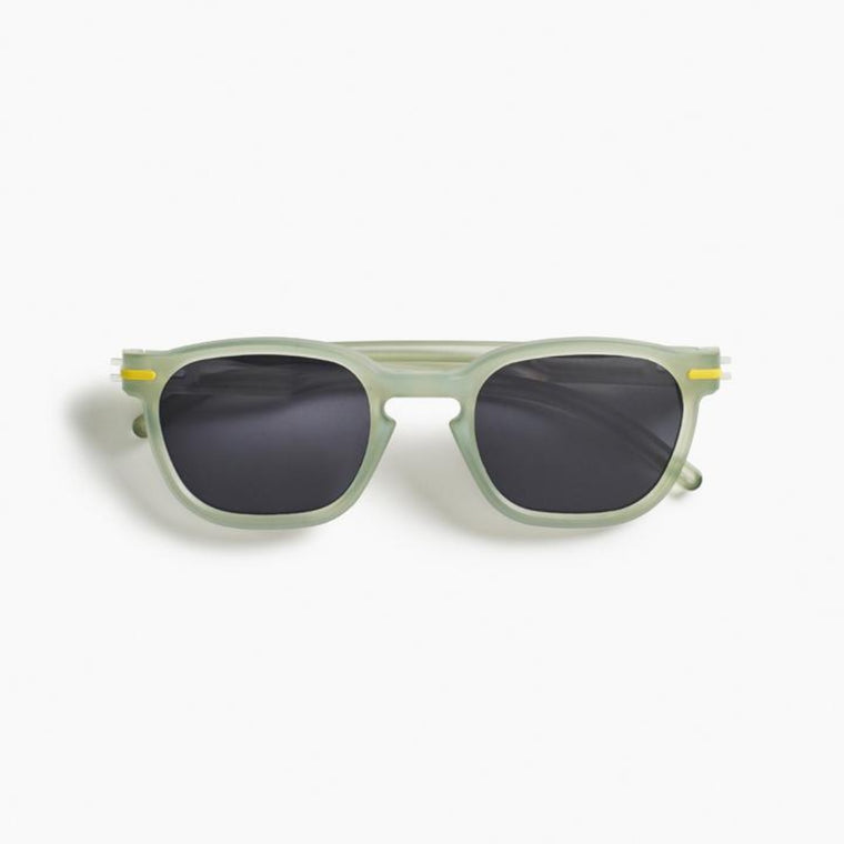 Image featuring a white background with classically designed square framed sunglasses in a lemonade yellow/green colour
