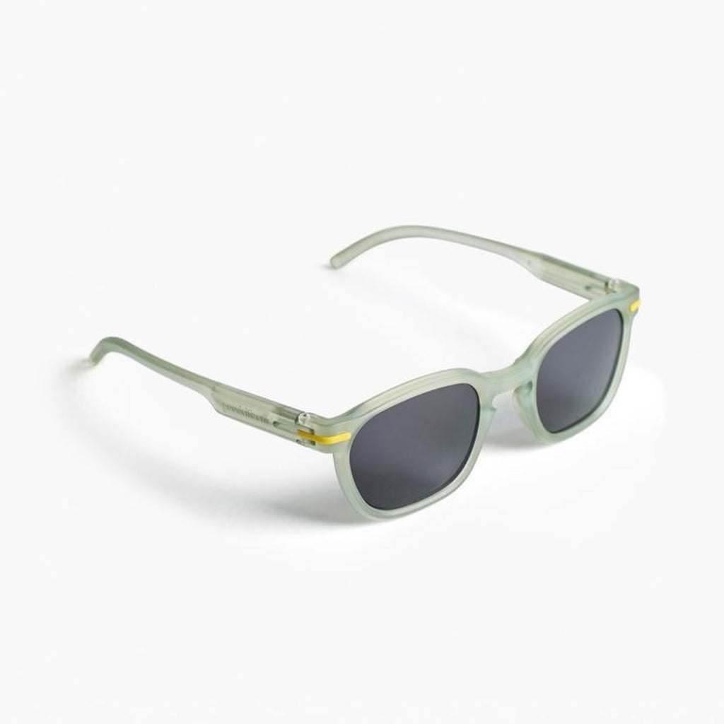 Image featuring a white background with classically designed square framed sunglasses in a lemonade yellow/green colour displayed on a right side angle