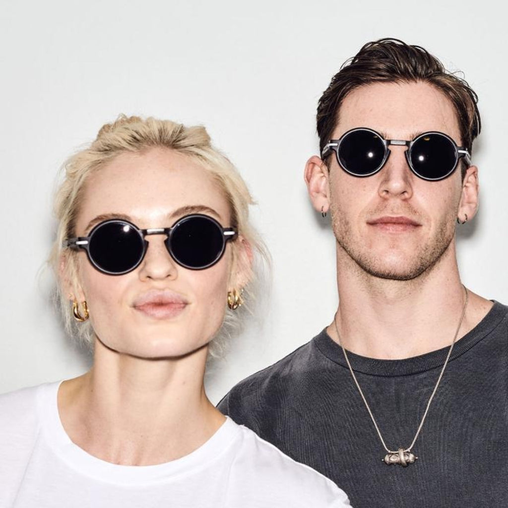 Image featuring two models, one male, one female both wearing casual clothing and featuring the Bronte sunglasses in cola/brown on their faces