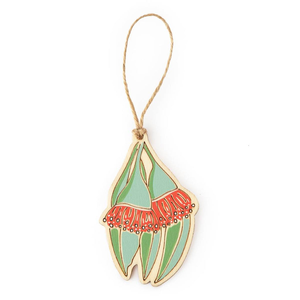 A hanging ornament in the form of a Gum Tree Blossom. Laser Etched flat wood is adorned with green, teal and red hand painting. A Jute string is attached