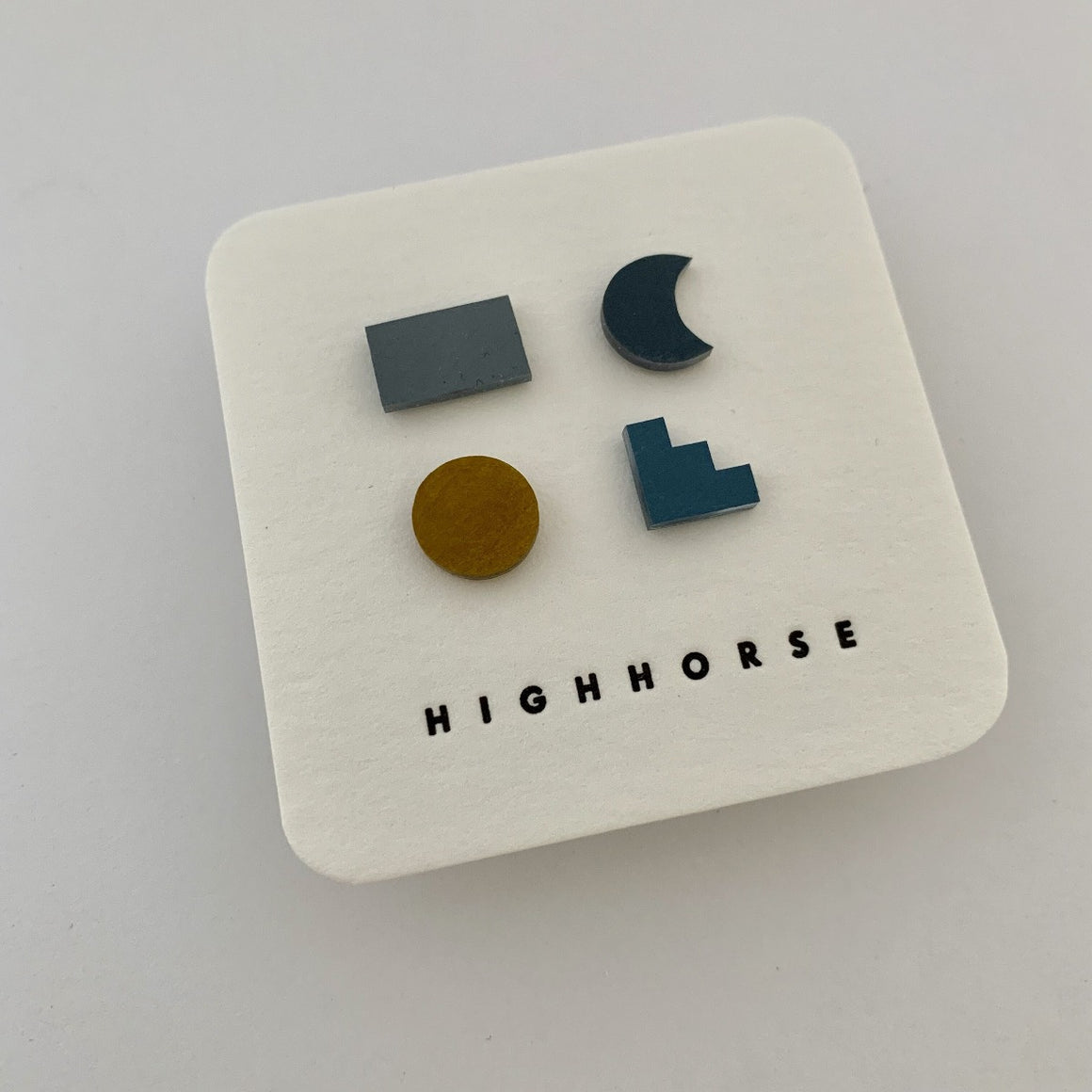 Earring stud set featuring a variety of shapes including colours grey, navy, mustard and light blue