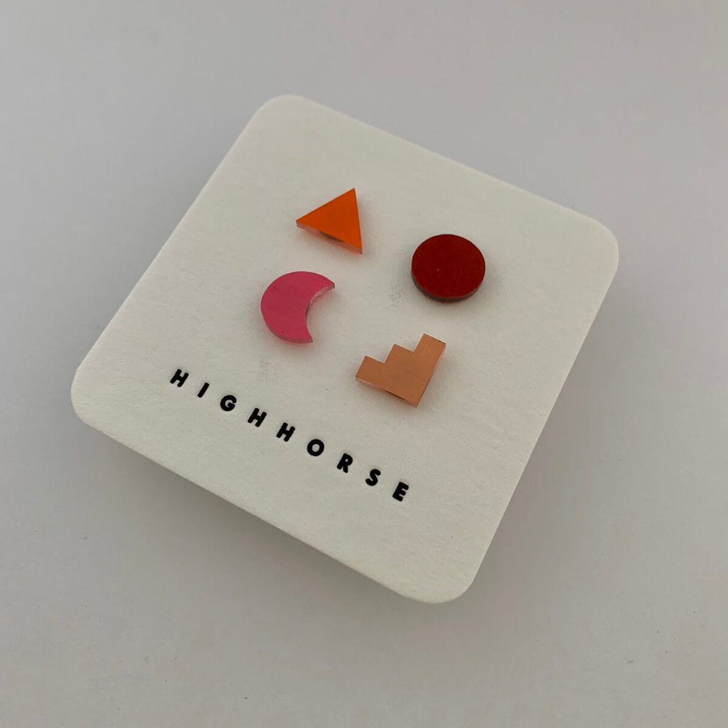 Earring stud set featuring a variety of shapes including colours orange, red, pink and light pink