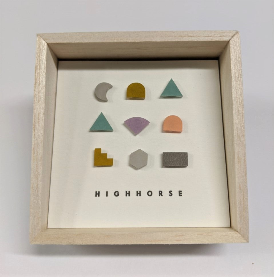 Timber box featuring earring studs including a variety of shapes which include colours of peach, lilac, mint, green, grey and red