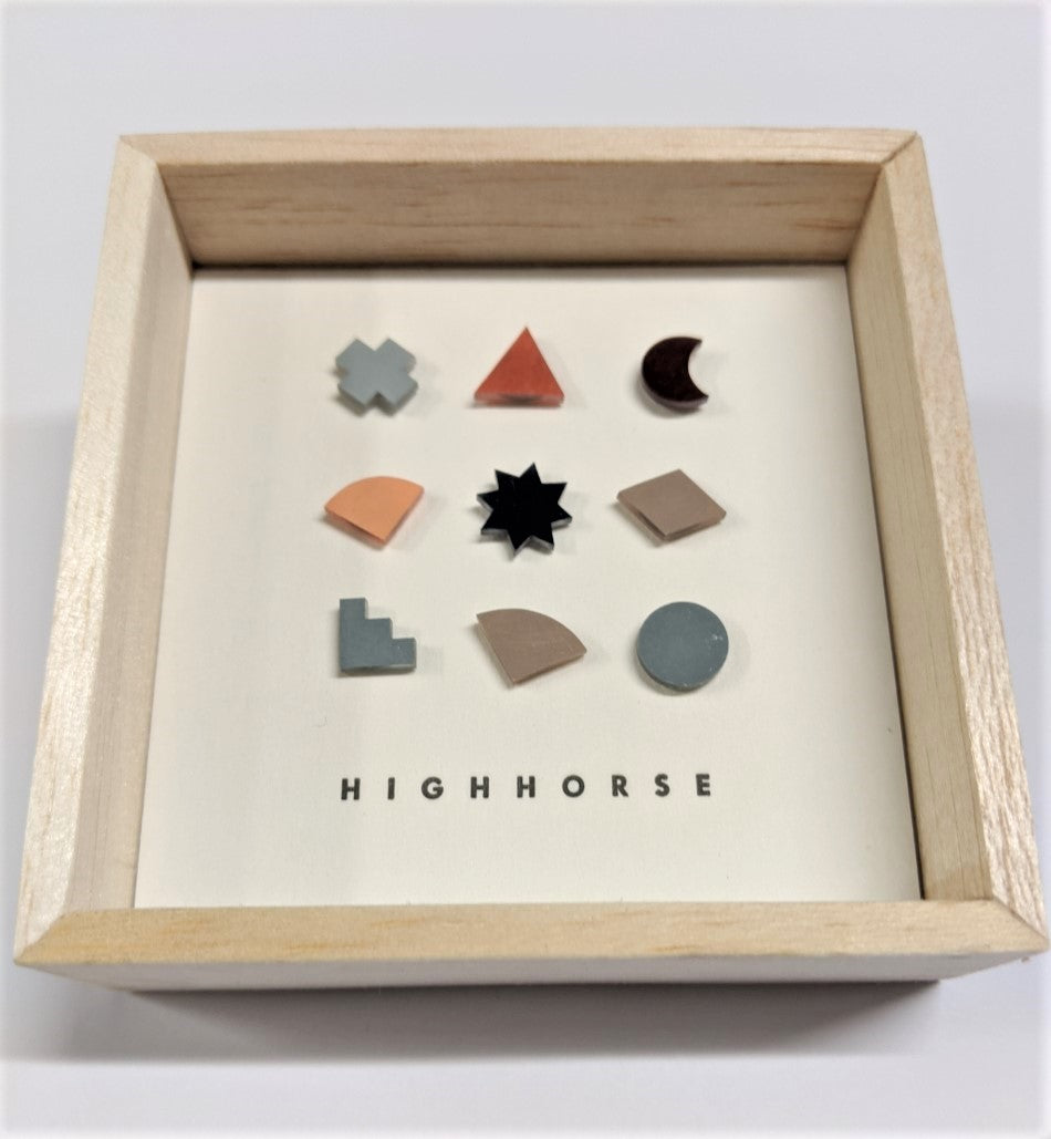 Timber box featuring earring studs including a variety of shapes which include colours of grey, mushroom, light grey, blue and mustard