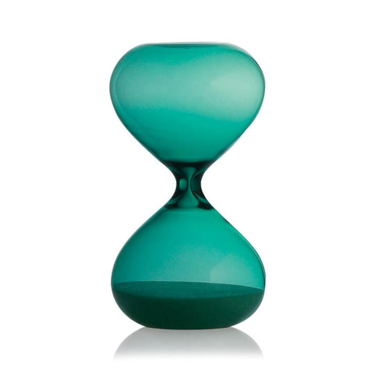 Image featuring a turquoise blue hour glass in the centre which includes sand on the botton of the hourglass