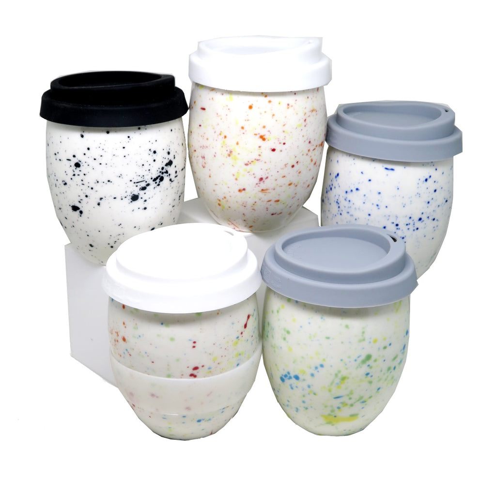 A Group of 5 Egg shaped reusable ceramic cups with Silicom sip lids.  Varying coloured 'speckle' glazes on white base.
