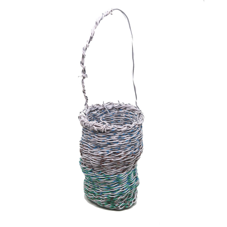 A highly intricate woven 'Mindi' basket created by Aboriginal Artist Emily Murray. It is constructed of woven plastic coated wire in white, grey, blue, green and brown.