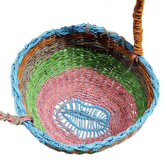 A highly intricate woven 'Mindi' basket created by Aboriginal Artist Emily Murray. It is constructed of woven plastic coated wire in pink, green, grey, orange and blue