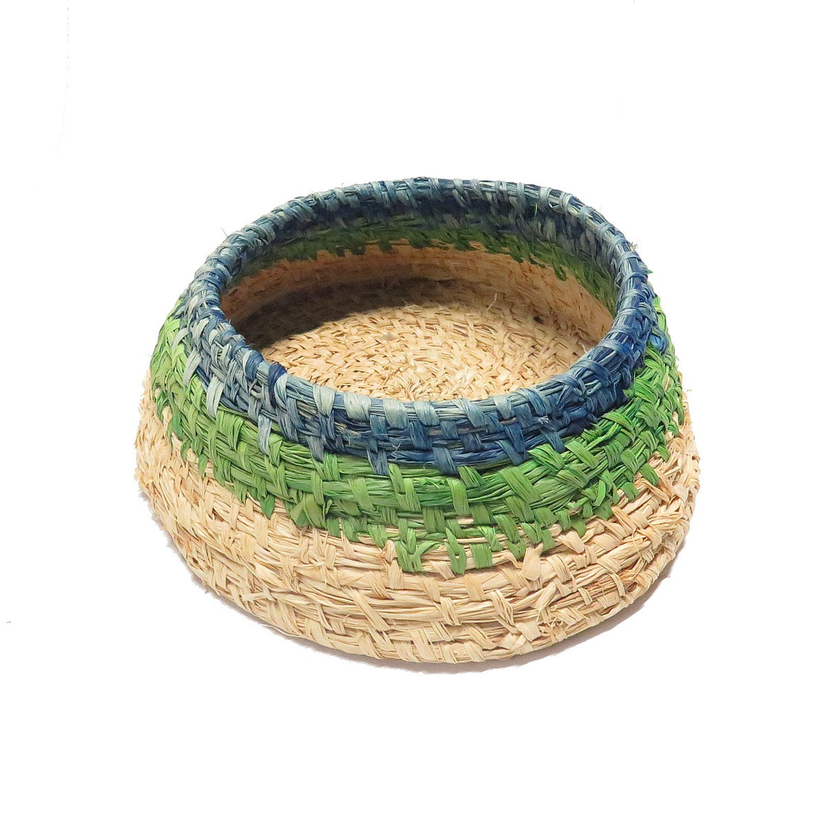 A woven made by indigenous artist Suzanna Armstrongi of Tjanpi Desert Weavers. It is made of dried grasses and raffia in blue, green and natural