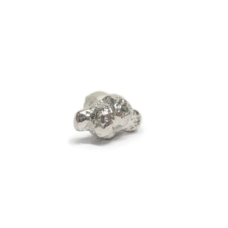 Image of an earring stud which holds a dough knot texture throughout