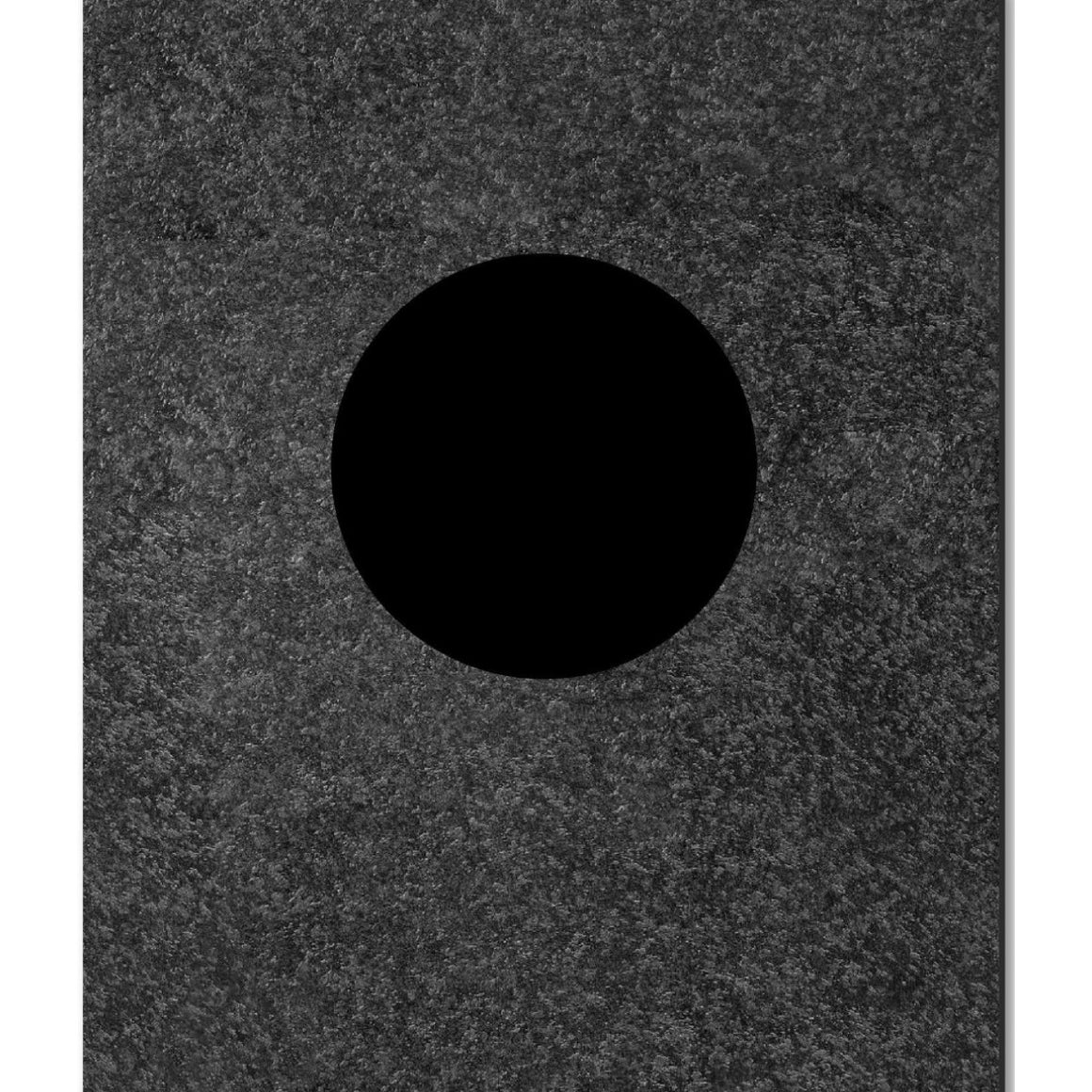 Image featuring a book cover with a black circle in the center with a grey pencil texture surrounding it