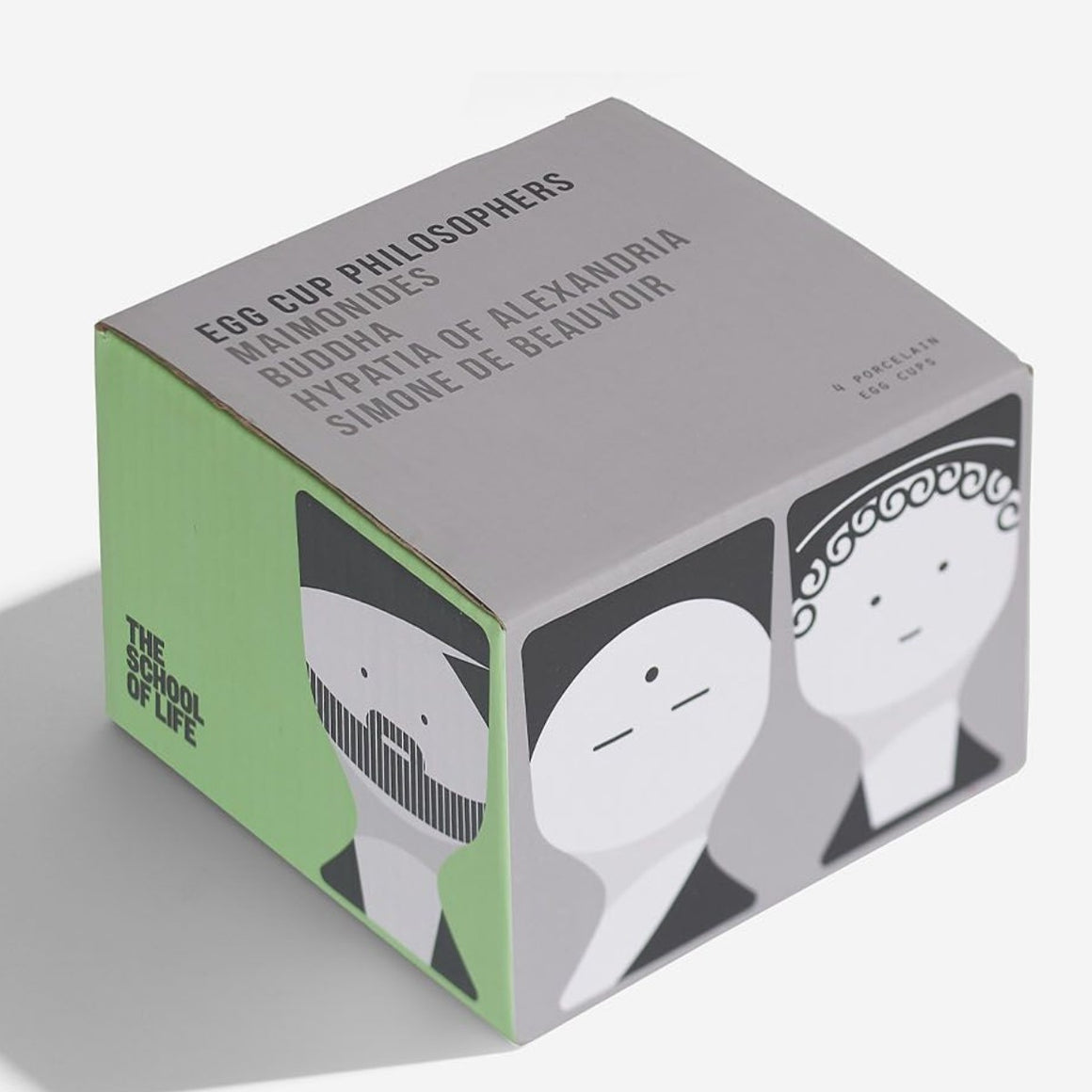 Image featuring a grey and green box with the top of the box includes the words Egg cup Philosophers Maimonides, Buddha, Hypatia of Alexandria and Simone De Beauvoir - around the bottom half of the box features graphic illustrations of the listed Philosophers