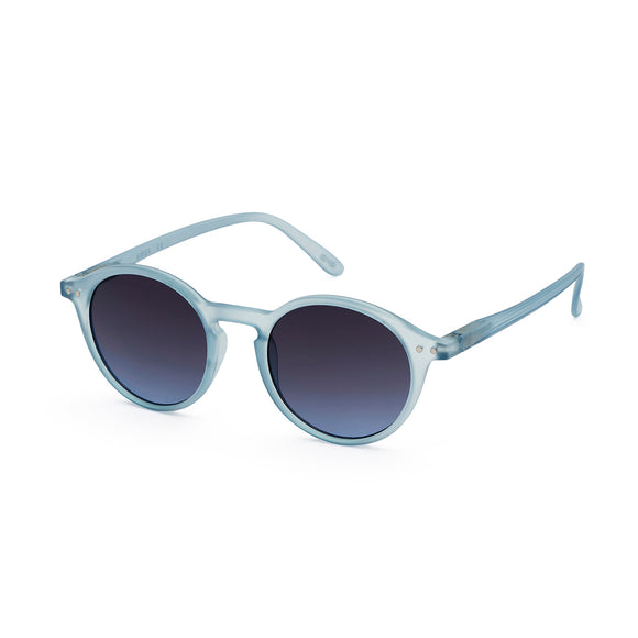 A rounded classic pair of IZIPIZI sunglasses in a very light pastel blue. The frames are a soft frosted acetate.