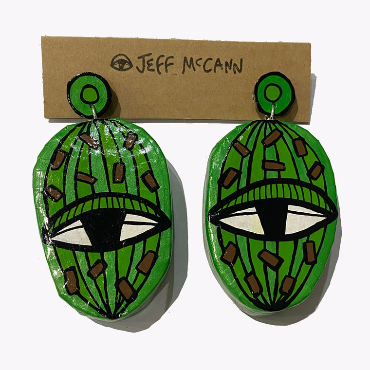 A 3D and sculptural pair of Jeff McCann drop earrings featuring  green ovals, eyes and cactus like shapes in green, teal and brown.