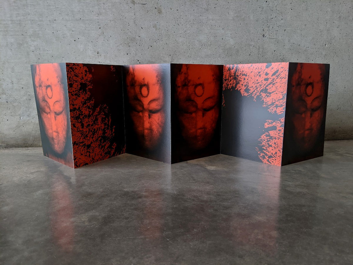 A concertina postcard set of 6 connected postcards is shown open. Each postcard features reproductions from the artwork 'Book of Kuan-Yin' in Red and Black. Displayed in front of a grey concrete wall.