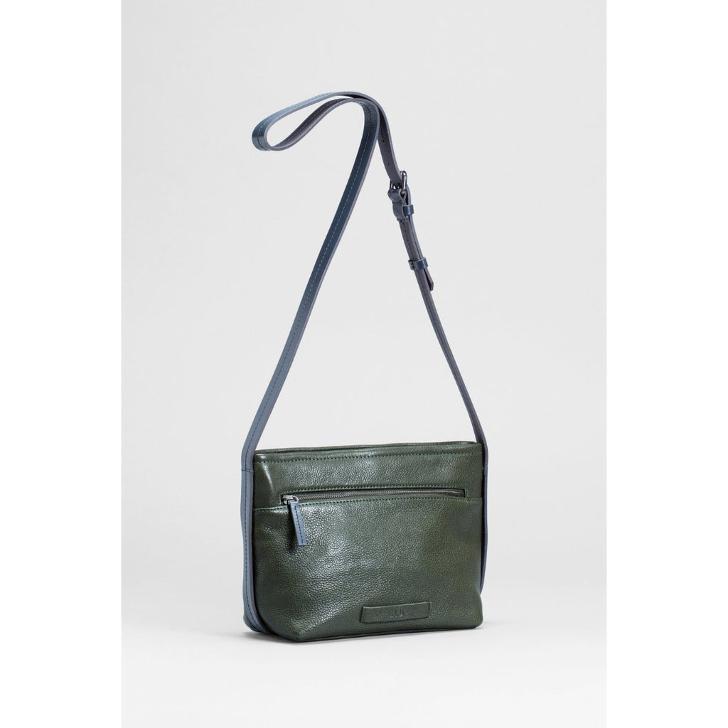 A deep green leather shoulder bag with a Navy Blue shoulder strap that extends around the sides and bottom of the bag.