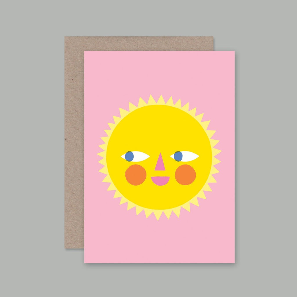A6 size greeting card featuring a pink background, with a graphic illustration of a sun that has eyes, cheeks and a smile