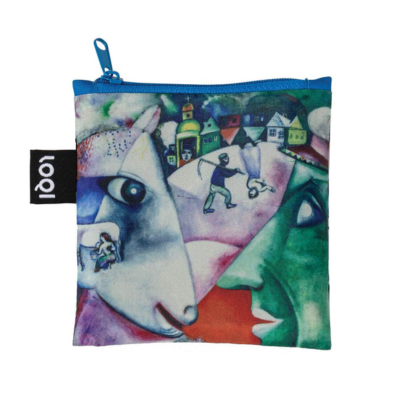 A colourful shopping bag, printed with Marc Chagall's artowk entitled I and the Village. There is a village, animals, people and abstract shapes.