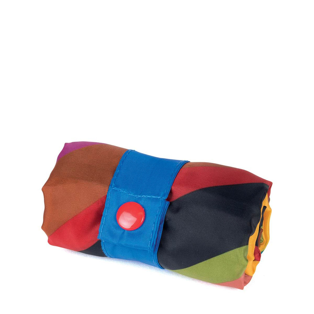 A multicoloured Shopping Bag rolled up showing strap buttoned closed.