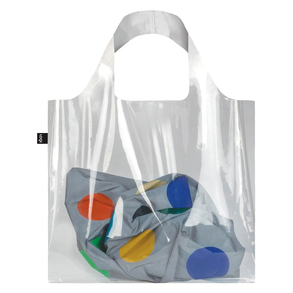 A shopping bag made of shiny transparent Polyurethane. A colourful scarf inside the bag is visible.