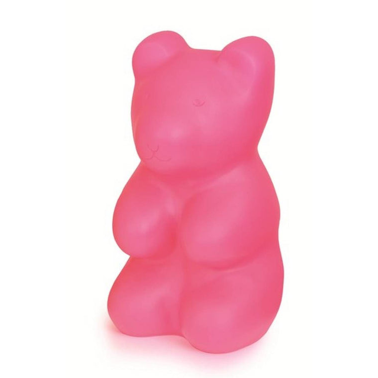 A large pink plastic moulded night light in the shape of an oversized gummy bear.