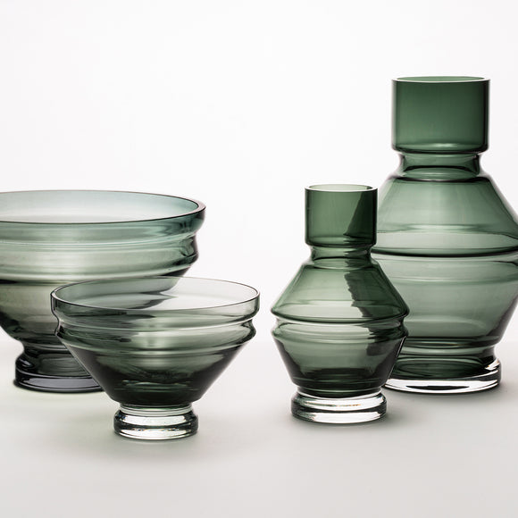 A structural and ridged glass vase in a cool grey tone