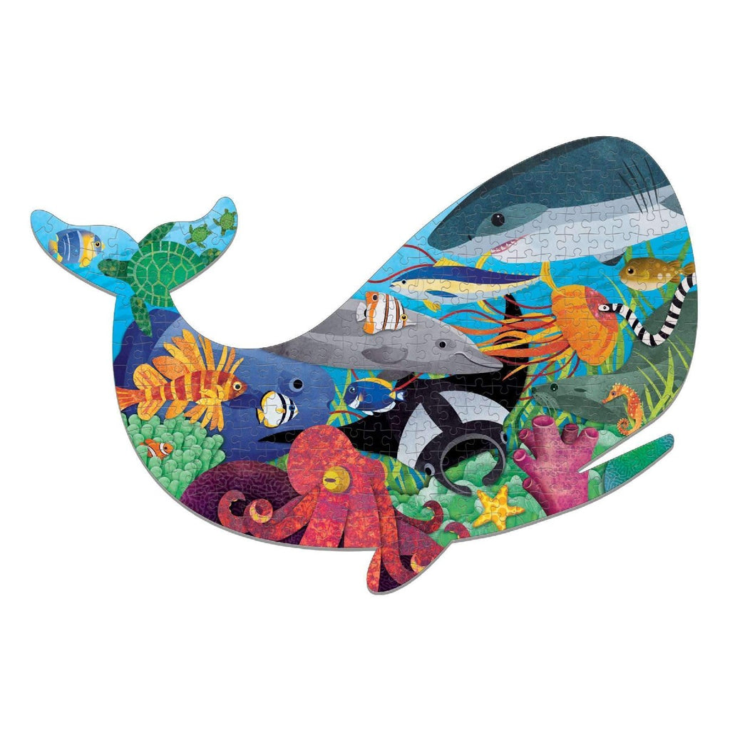A puzzle in the shape of a whale featuring an illustration of n array of sea life.