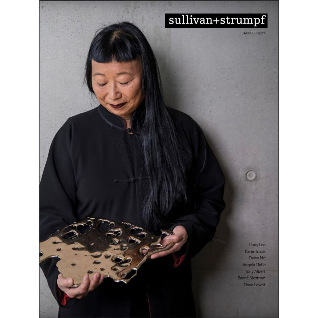 A magazine cover shows artist Lindy Lee holding a flung bronze.