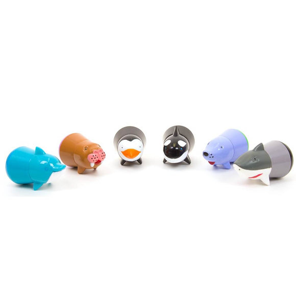 A set of six coloured stubby markers. The body of each marker is shaped like a different underwater and marine animals including a penguin, shark, seal, walrus, dolphin and killer whale.