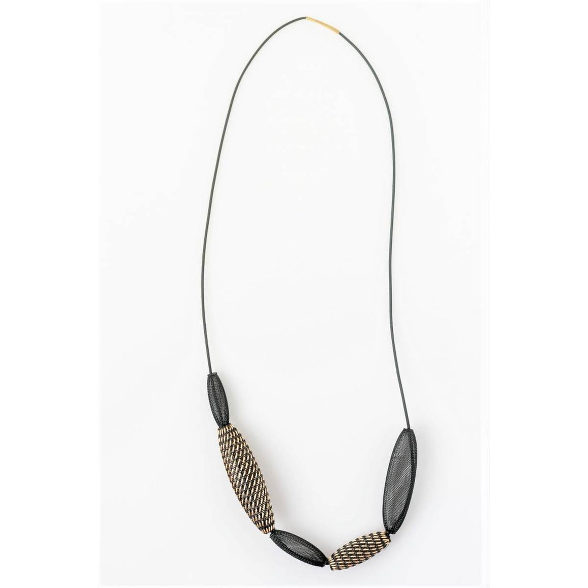 A necklace in bronze and black. Five variegated beads made of heat treated nylon are strung on a waxed cotton.
