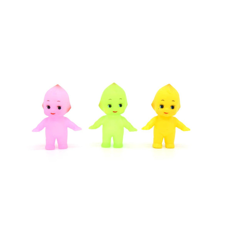 Three vintage style Kewpie dolls, shown standing in a line. They are pink, green and yellow respectively. The dolls are cherub- like and features large eyes with distinct eyelashes.